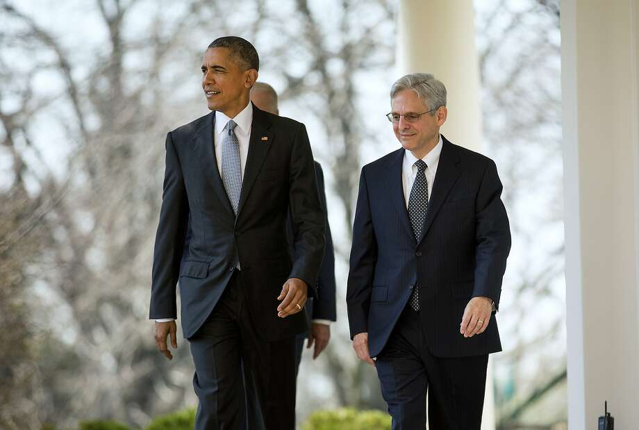 FILE — President Barack Obama walks out with Judge Merrick Garland to introduce him as his Supreme Court nominee, at the White House in Washington, March 16, 2016. In his years on the U.S. Court of Appeals' D.C. Circuit, Garland frequently deferred to the government in wartime detention cases. (Doug Mills/The New York Times) Photo: DOUG MILLS, NYT