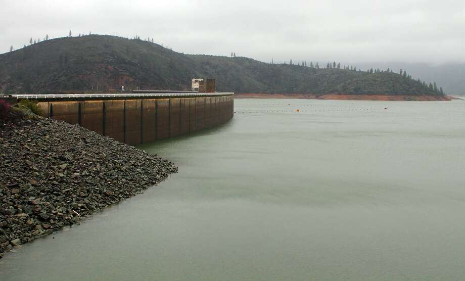 The shore of Lake Shasta behind Shasta Dam in Lake Shasta, Calif., is seen Sunday, March 13, 2016. The lake's water level has been rising after a series of storms brought strong winds, periods of heavy rain, snow and high surf to California Sunday, the fourth straight day of wet weather. The lake is rising after several years of dropping water levels due to the ongoing California drought. (Nathan Solis/The Record Searchlight via AP) Photo: Nathan Solis, AP
