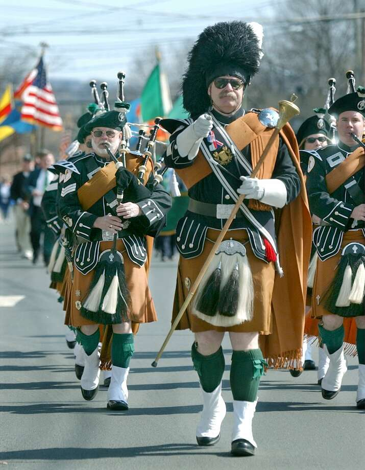 Dan McGee, Pipe Major for the Celtic Cross Pipe and Drum Corps of Danbury, leads them in the St. Patrick's Day Parade on  Main St in Danbury Sunday (which was not St. Patrick's Day) Photo: File Photo\Carol Kaliff / File Photo / The News-Times File Photo