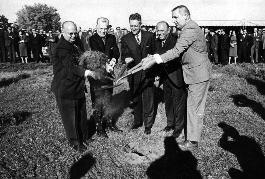 Elected officials and store executives join in a groundbreaking ceremony for new Colonie Center on Oct. 16, 1964, in Colonie, N.Y. (Times Union archive) Photo: None