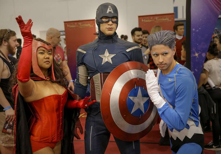 Karla Dajano, as the Scarlet Witch and Ronald Camposanto as Quicksilver pose with the Madame Tussauds wax figure of Captain America during the Silicon Valley Comic Con 2016. Photo: Michael Macor, The Chronicle