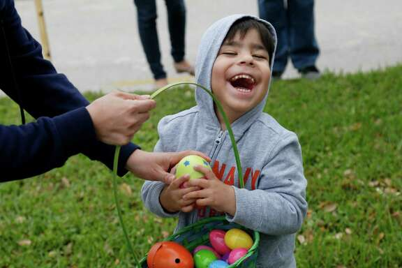 Angel Rodriguez, 4, who is completely blind, plays with his mom Gabriela Favela during the annual Beeping Easter Egg Hunt at The Lighthouse Saturday, March 19, 2016, in Houston.