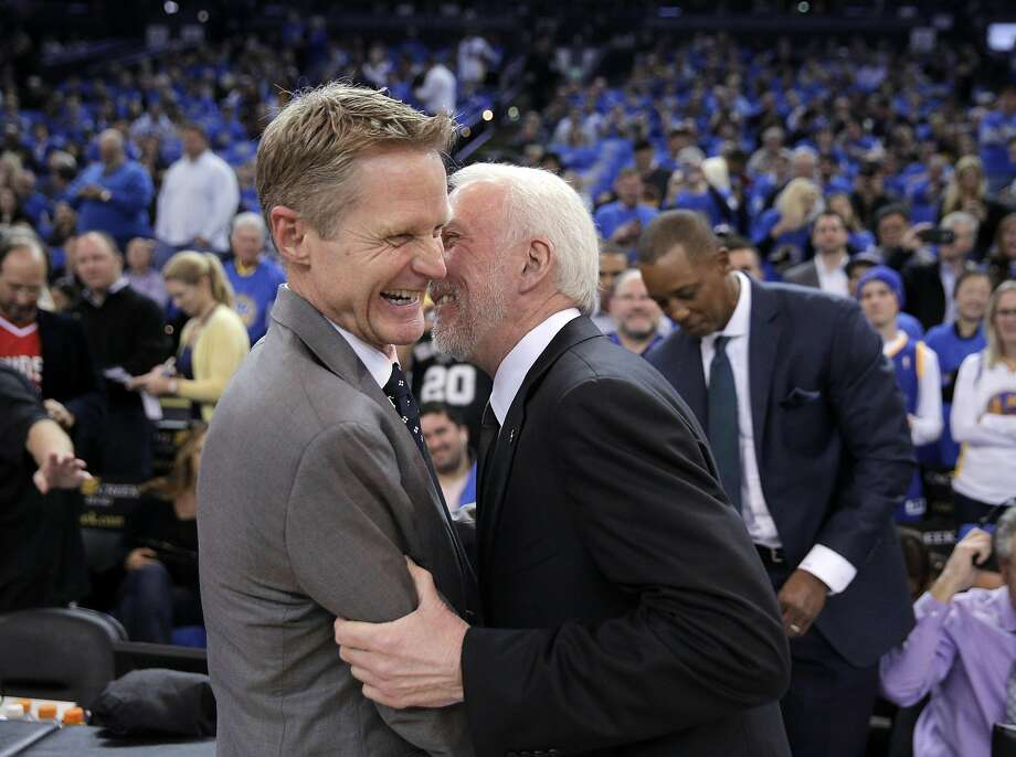 Warriors head coach Steve Kerr shares a moment with Gregg Popovich before the first half of the Golden State Warriors game against the San Antonio Spurs at Oracle Arena in Oakland, Calif., on Monday, January 25, 2016. Photo: Carlos Avila Gonzalez, The Chronicle