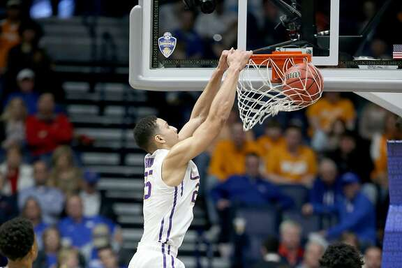 NASHVILLE, TN - MARCH 11:  Ben Simmons #25 of the LSU Tigers dunks the ball during the game against the Tennessee Volunteers during the quarterfinals of the SEC Basketball Tournament at Bridgestone Arena on March 11, 2016 in Nashville, Tennessee.  (Photo by Andy Lyons/Getty Images)