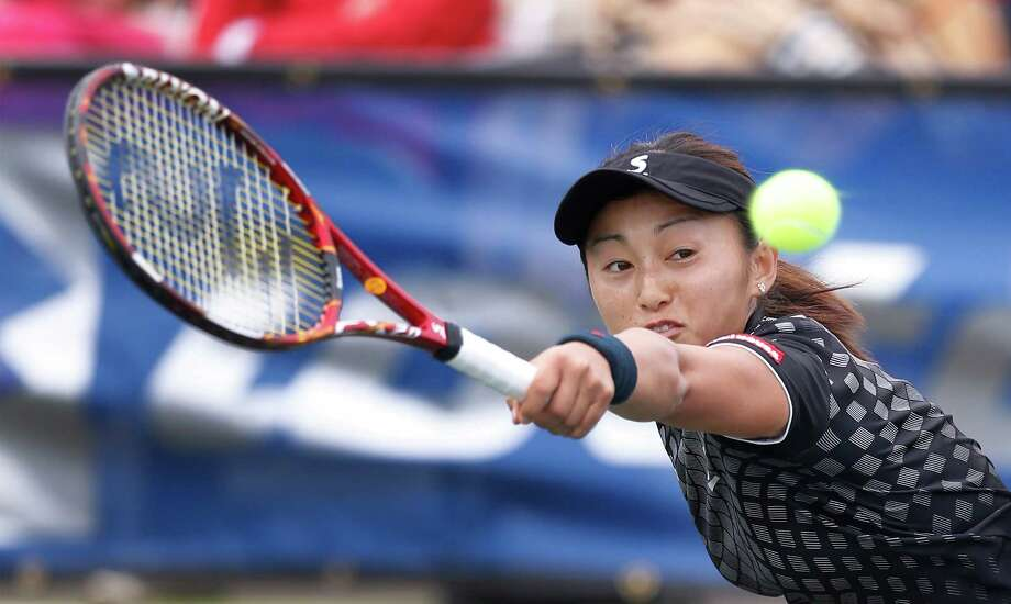 Japan's Misaki Doi hits a backhand against Germany's Anna-Lena Friedsam in the 2016 San Antonio Tennis Open finals at McFarlin Tennis Center on Saturday, Mar. 19, 2016. Sixth-seeded Doi defeated Friedsam 6-4, 6-2 to win the first professional tennis tournament in San Antonio since 1991. (Kin Man Hui/San Antonio Express-News) Photo: Kin Man Hui, Staff / San Antonio Express-News / ©2016 San Antonio Express-News