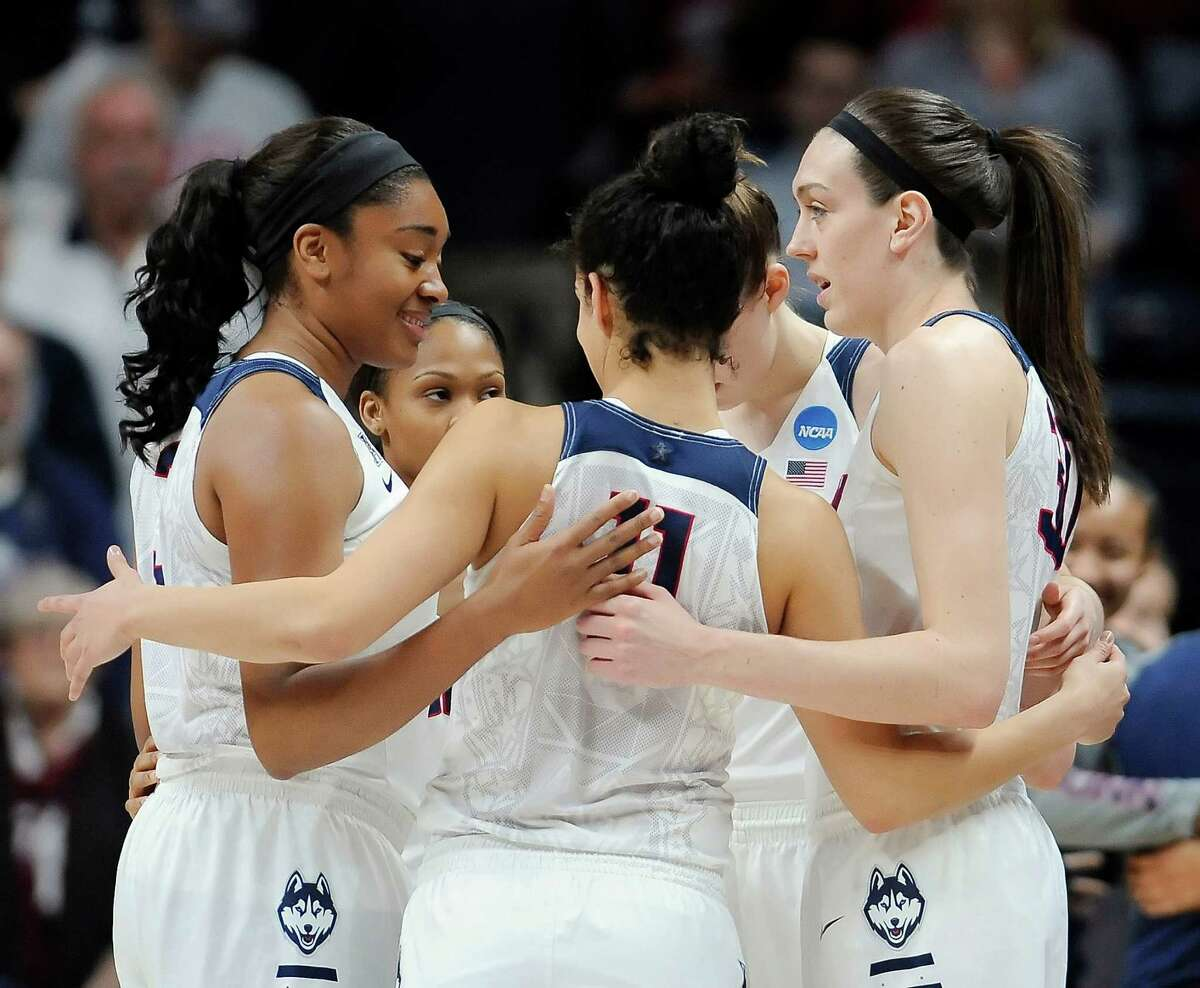 Connecticut players huddle together during a first round women's college basketball game against Robert Morris in the NCAA Tournament, Saturday, March 19, 2016, in Storrs, Conn.