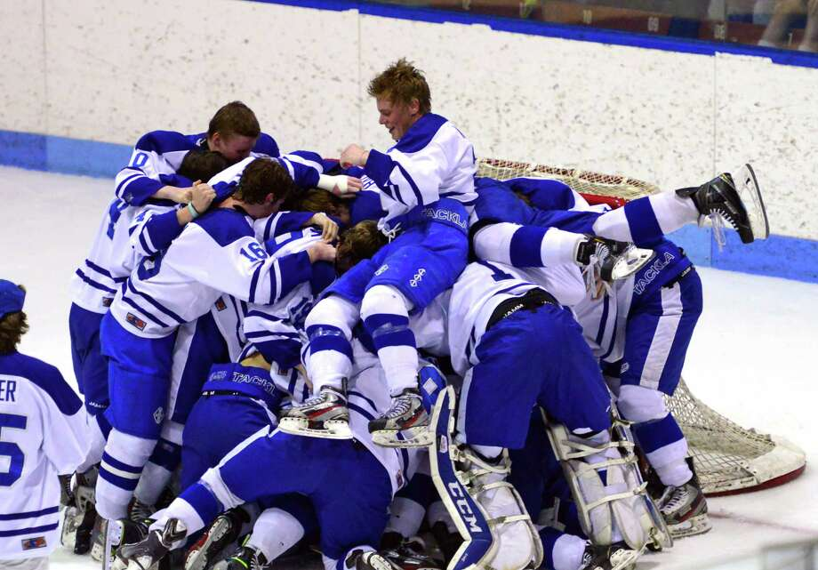 Darien celebrates its win over Fairfield Prep in Division I boys hockey finals action in New Haven, Conn., on Saturday March 19, 2016. Photo: Christian Abraham / Hearst Connecticut Media / Connecticut Post