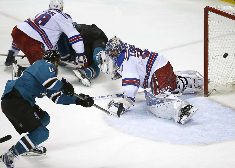 Sharks center Joe Thornton fires the go-ahead goal past Rangers goalie Henrik Lundqvist. Photo: Tony Avelar, AP