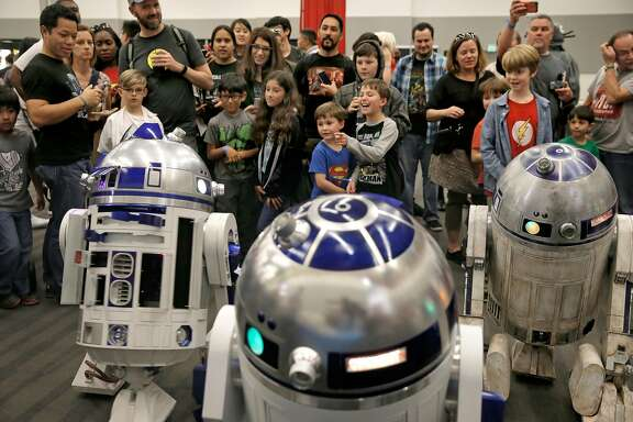 R2 Builders, enthusiasts of the Star Wars droids display their creations for the visitors to see during the Silicon Valley Comic Con 2016, on Sat.  March 19, 2016, at the San Jose Convention Center in San Jose, California.