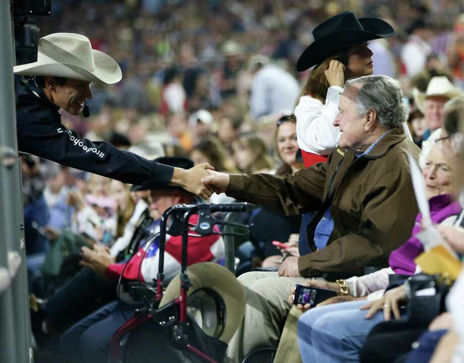 Former President George Bush shakes hands with Kevin Gilbert during the Super Series Championship at the Houston Livestock Show and Rodeo in NRG Stadium, Saturday, March 19, 2016. Photo: Karen Warren, Houston Chronicle / © 2016  Houston Chronicle