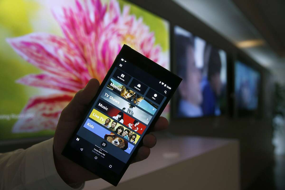Carlos Angulo, a senior product marketing manager at Vizio, holds the 6-inch Android tablet remote control for the new P-Series line of SmartCast 4K ultra high-definition television monitors and audio equipment in San Francisco, Calif. on Friday, March 11, 2016.
