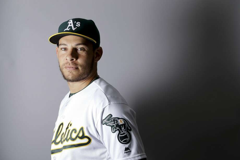 Danny Valencia poses for a photo on A's picture day. Photo: Chris Carlson, AP