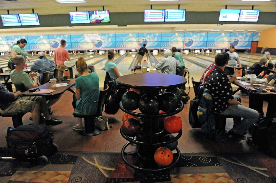 Go bowling on Dollar Nights. Albany Sunset Lanes and Del Lanes in Delmar both offer discount nights where bowling shoes, games, pizza and soda are all $1. Photo: Michael P. Farrell / 10035789A