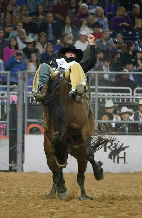 Kaycee Feild competes and goes on to win the bareback riding championship during the Super Series Championship at the Houston Livestock Show and Rodeo in NRG Stadium, Saturday, March 19, 2016. Photo: Karen Warren, Houston Chronicle / © 2016  Houston Chronicle