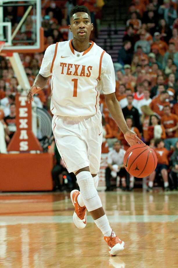 AUSTIN, TX - FEBRUARY 11:  Isaiah Taylor #1 of the Texas Longhorns brings the ball up court against the Oklahoma State Cowboys on February 11, 2014 at the Frank Erwin Center in Austin, Texas.  (Photo by Cooper Neill/Getty Images) Photo: Cooper Neill, Stringer / 2014 Getty Images
