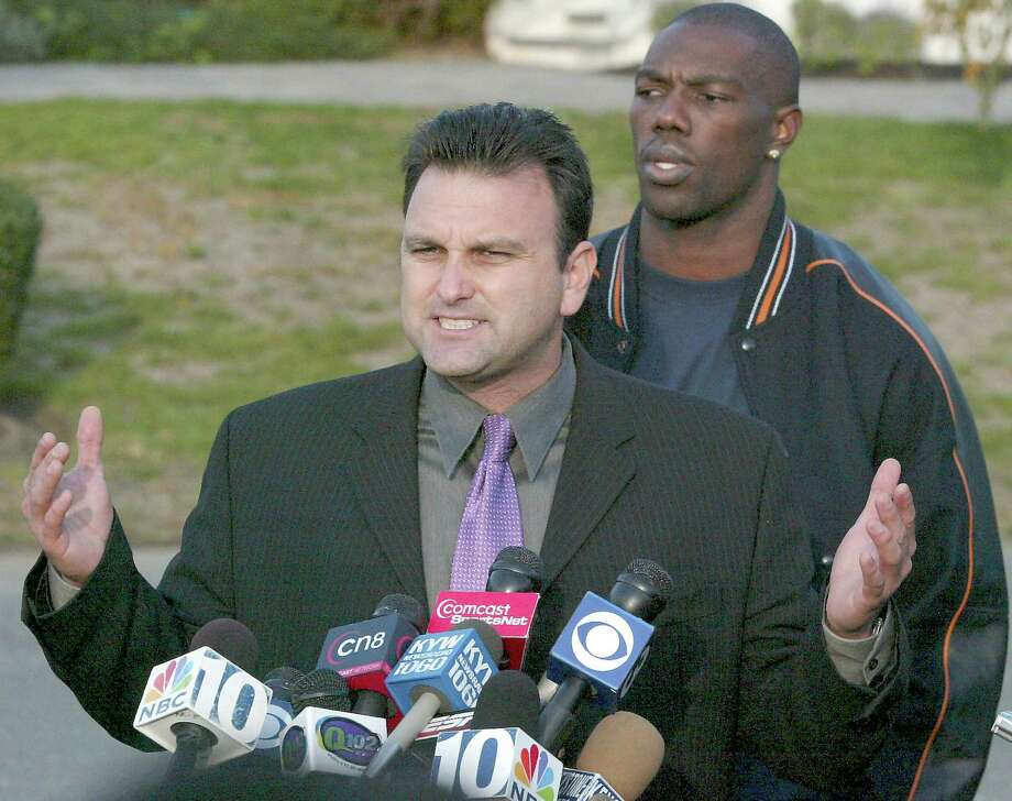 Sports agent Drew Rosenhaus (front) answers questions as Philadelphia Eagles' suspended wide receiver Terrell Owens (rear) looks on during a news conference at Owens' residence in Moorestown, New Jersey, November 8, 2005. Owens read a brief statement with a series of apologies in the hopes of returning to the Philadelphia Eagles. REUTERS/Tim Shaffer  Ran on: 11-09-2005 Agent Drew Rosenhaus answers questions as Terrell Owens, the Eagles' suspended receiver, looks on.  Ran on: 11-09-2005 Agent Drew Rosenhaus said of Terrell Owens, &quo;Let me assure you he will be playing in the future.&quo; Photo: TIM SHAFFER, REUTERS / X01383