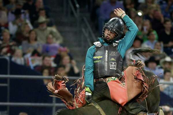 Sage Kimzey competes and wins the bull riding championship during the Super Series Championship at the Houston Livestock Show and Rodeo in NRG Stadium, Saturday, March 19, 2016.