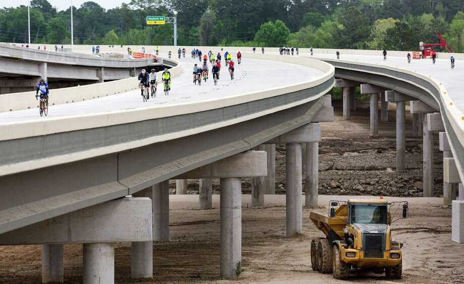 Bicyclists ride along the newest section of the Grand Parkway. Take a look at these size comparison to see just how big Houston's outer loop really is. Photo: Craig Hartley, Freelance / Copyright: Craig H. Hartley