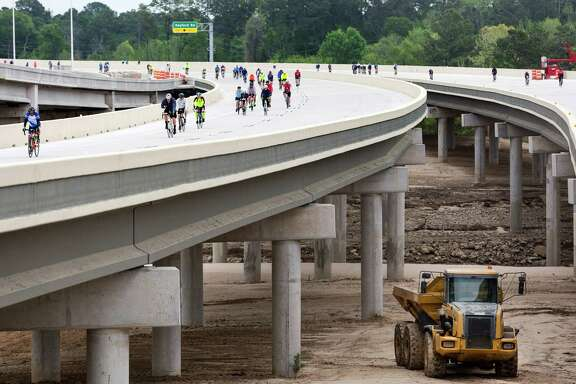 Almost 1,000 bicyclists signed up to participate in Saturday morning's ride along the newest section of the Grand Parkway.