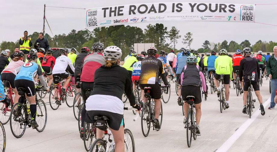 A banner greets bicyclists along the Grand Parkway on March 19. The stretch from Interstate 45 to U.S. 59 will open Tuesday. Photo: Craig Hartley, Freelance / Copyright: Craig H. Hartley