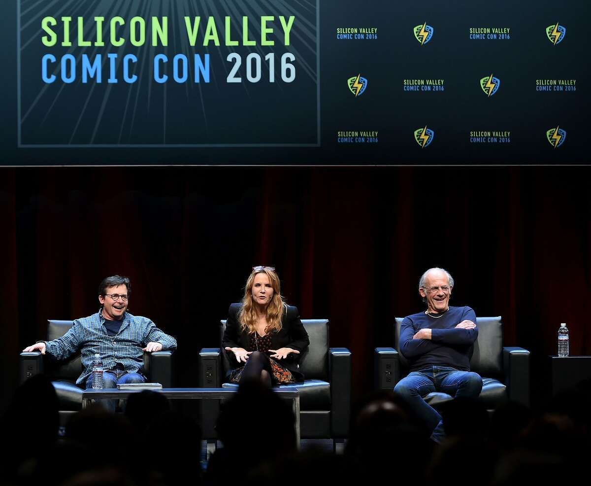 Michael J. Fox (L), Lea Thompson (C) and Christopher Lloyd (R) take part in a panel discussion on