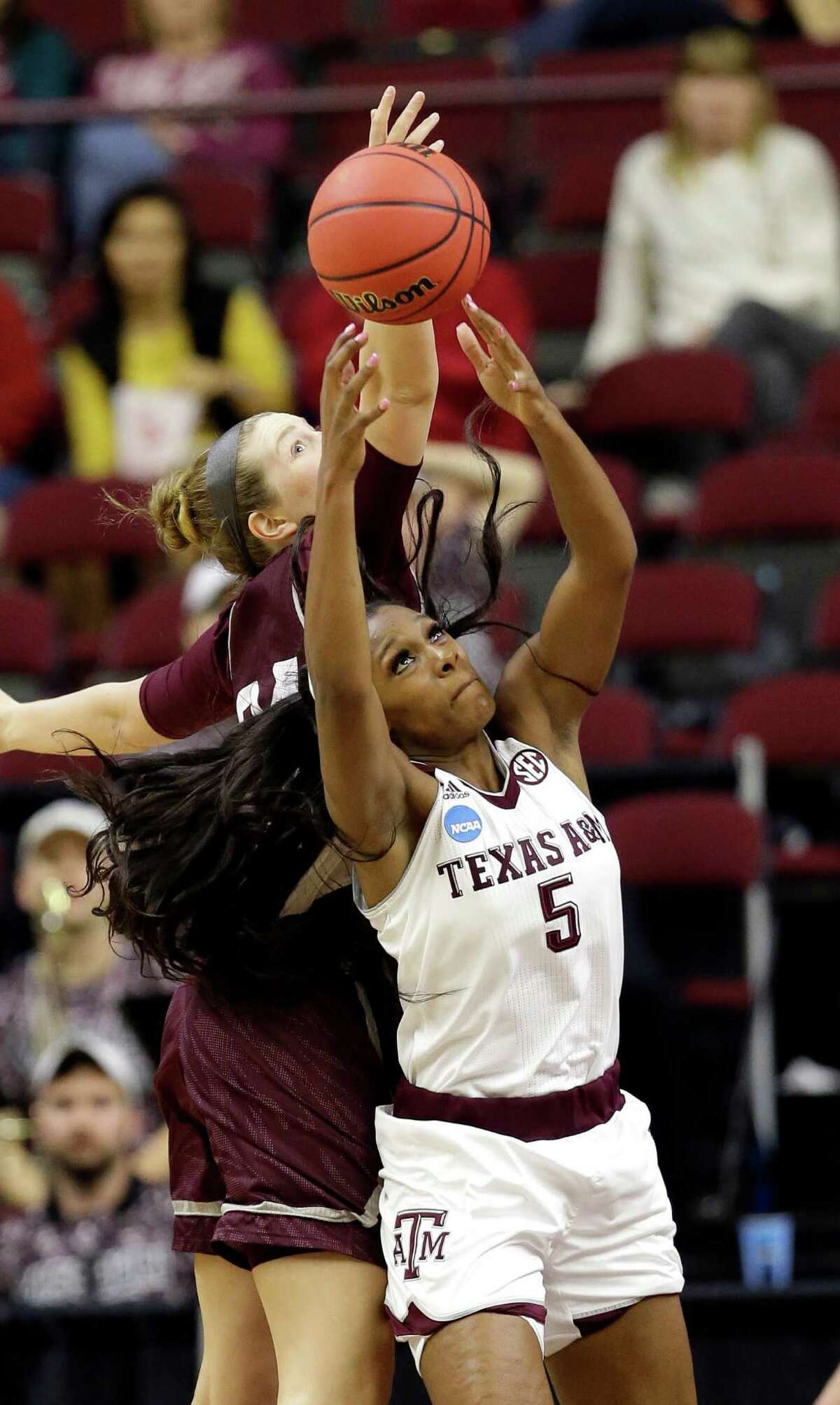 Texas A&M's Anriel Howard (5) pulls down a rebound - one of an NCAA Tournament-record 27 pulled down by the freshman - in the second half of Saturday's victory over Missouri State.