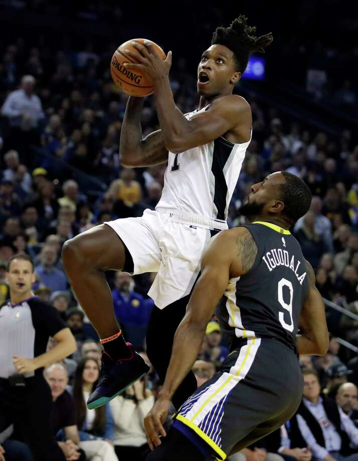 San Antonio Spurs' Rudy Gay, left, shoots against Golden State Warriors' JaVale McGee (1) during the first quarter in Game 2 of a first-round NBA basketball playoff series Monday, April 16, 2018, in Oakland, Calif. (AP Photo/Ben Margot) Photo: Ben Margot, Associated Press / Copyright 2018 The Associated Press. All rights reserved.