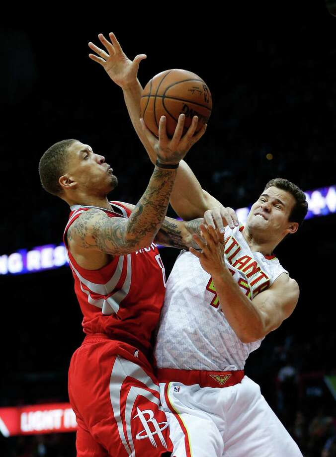 Houston Rockets forward Michael Beasley (8) goes up for a shot against Atlanta Hawks forward Kris Humphries (43) in the second half of an NBA basketball game, Saturday, March 19, 2016, in Atlanta. Photo: John Bazemore, AP / AP