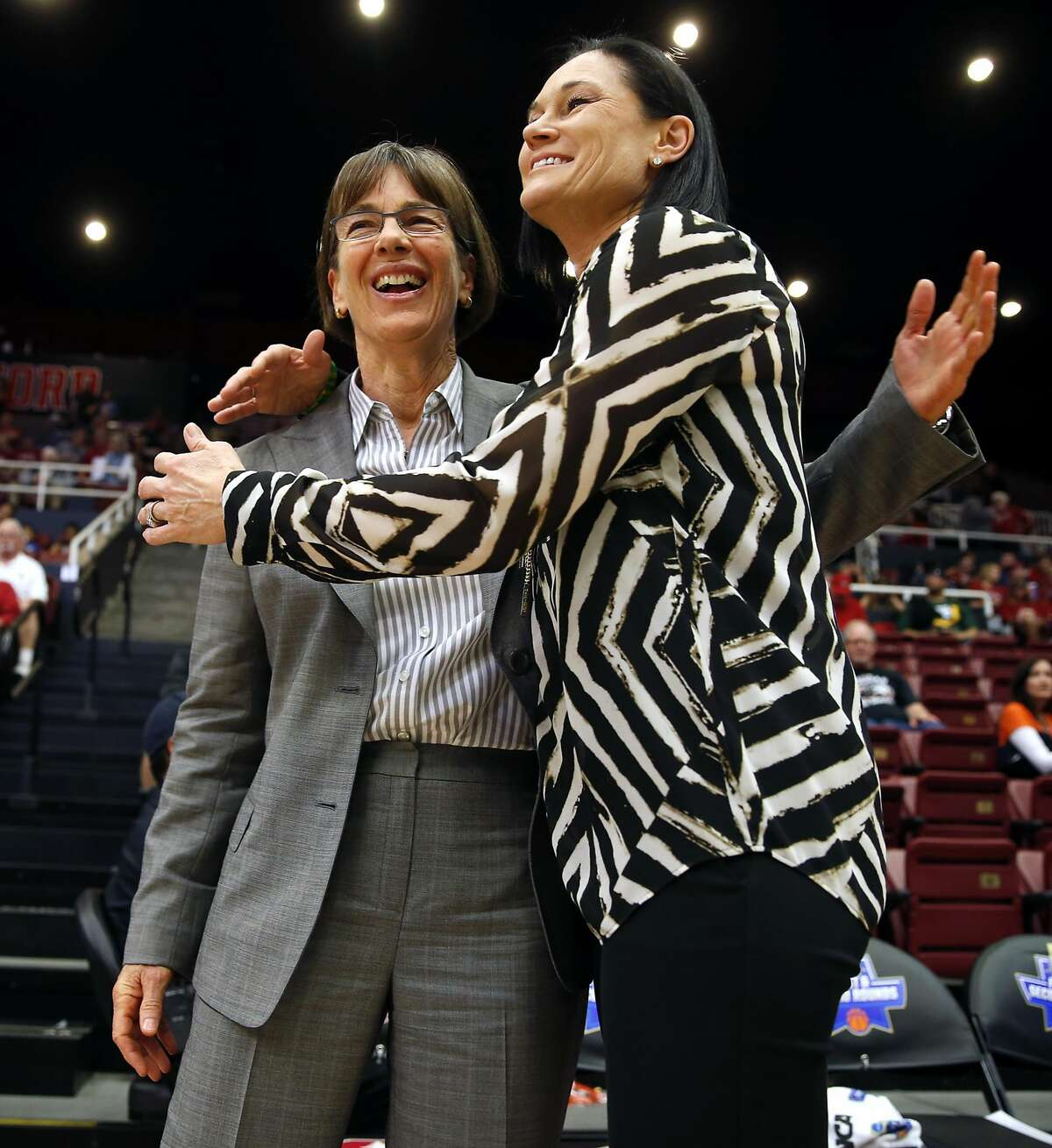 Stanford head coach Tara VanDerveer (left) and San Francisco head coach Jennifer Azzi embrace before their team's faced off during 2016 NCAA Division 1 Women's Basketball Tournament game at Maples Pavilion in Stanford, Calif., on Saturday, March 19, 2016.