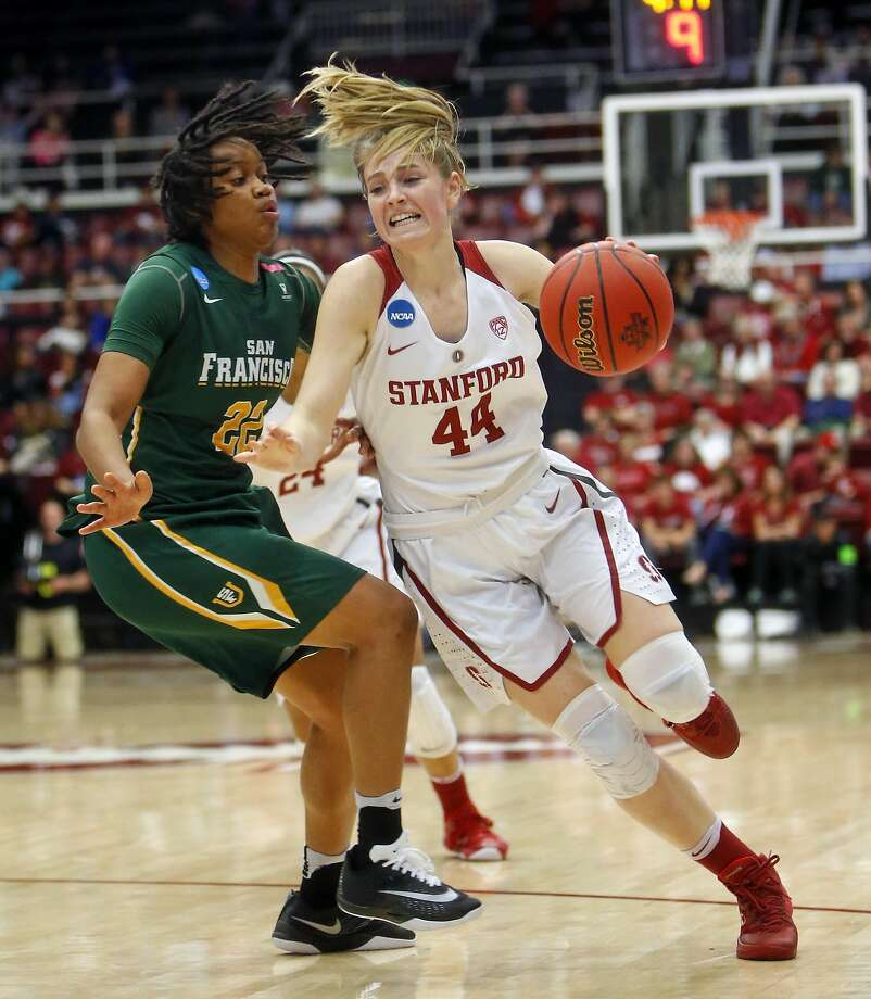 Stanford's Karlie Samuelson, who scored 11 points, drives past USF's Claudia Price in second quarter. Photo: Scott Strazzante, The Chronicle