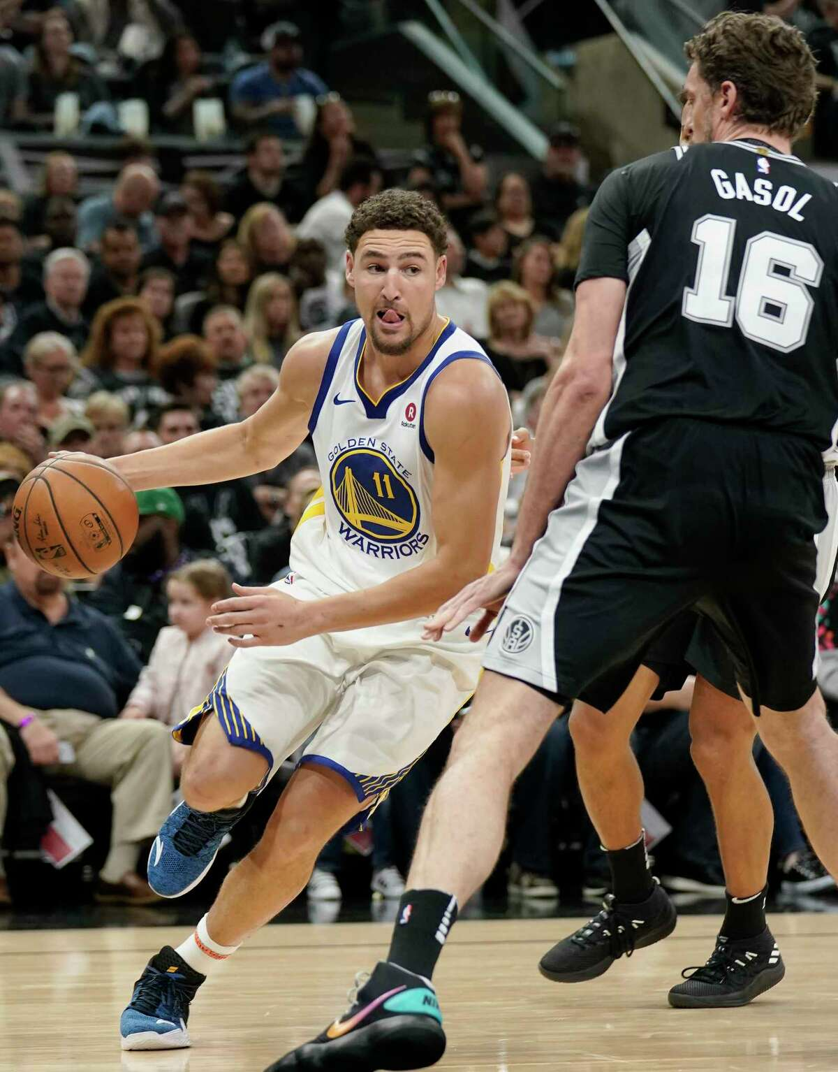 Golden State Warriors' Klay Thompson (11) drives against San Antonio Spurs' Pau Gasol during the first half of Game 4 of a first-round NBA basketball playoff series in San Antonio, Sunday, April 22, 2018, in San Antonio. (AP Photo/Darren Abate)