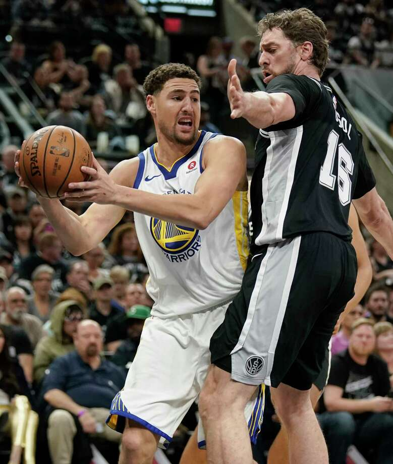 Golden State Warriors' Klay Thompson, left, looks to pass around San Antonio Spurs' Pau Gasol during the first half of Game 4 of a first-round NBA basketball playoff series in San Antonio, Sunday, April 22, 2018, in San Antonio. (AP Photo/Darren Abate) Photo: Darren Abate, Associated Press / FR115 AP
