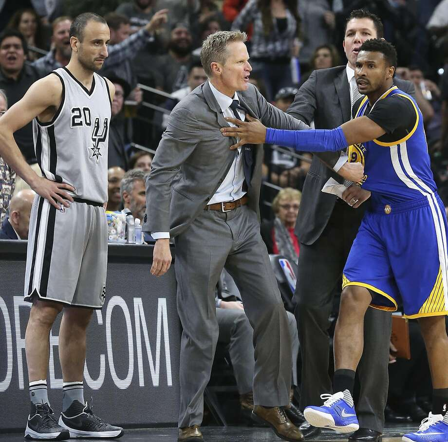 Warriors coach Steve Kerr is restrained after getting a technical as the Spurs host the Warriors at the AT&T Center  on March 19, 2016. Photo: TOM REEL, SAN ANTONIO EXPRESS-NEWS