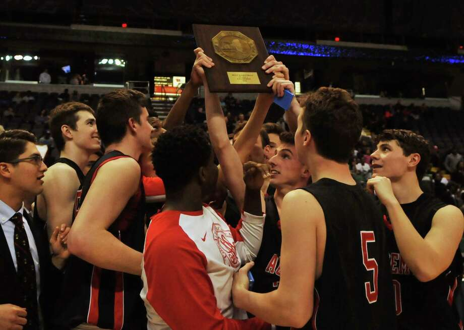 Members of the Albany Academy basketball team showcase their trophy after winning the Class A Federation Tournament of Champions. Photo taken on Saturday, March 20, 2016, in the Times Union Center, Albany, N.Y. (Brittany Gregory / Special to the Times Union) Photo: Brittany Gregory / 10035886A