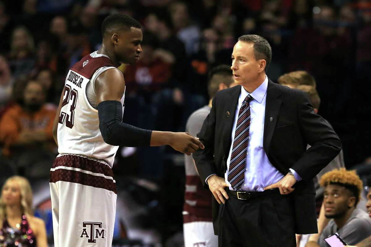 Texas A&M coach Billy Kennedy talks strategy with Danuel House during the Aggies' win over Wisconsin-Green Bay on Friday in the first round of the NCAA Tournament.