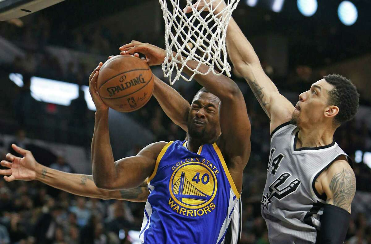 SAN ANTONIO, TX - MARCH 19: Harrison Barnes #40 of the Golden States Warriors has his shot blocked by Kawhi Leonard #2 of the San Antonio Spurs,not visible, and Danny Green #14 of the San Antonio Spurs at AT&T Center on March 19, 2016 in San Antonio, Texas. NOTE TO USER: User expressly acknowledges and agrees that , by downloading and or using this photograph, User is consenting to the terms and conditions of the Getty Images License Agreement.