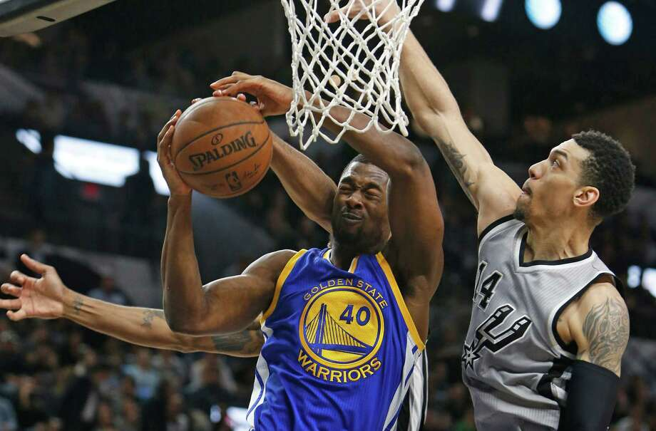 SAN ANTONIO, TX - MARCH 19: Harrison Barnes #40 of the Golden States Warriors has his shot blocked by Kawhi Leonard #2 of the San Antonio Spurs,not visible, and Danny Green #14 of the San Antonio Spurs at AT&T Center on March 19, 2016 in San Antonio, Texas.  NOTE TO USER: User expressly acknowledges and agrees that , by downloading and or using this photograph, User is consenting to the terms and conditions of the Getty Images License Agreement. Photo: Ronald Cortes, Getty Images / 2016 Getty Images