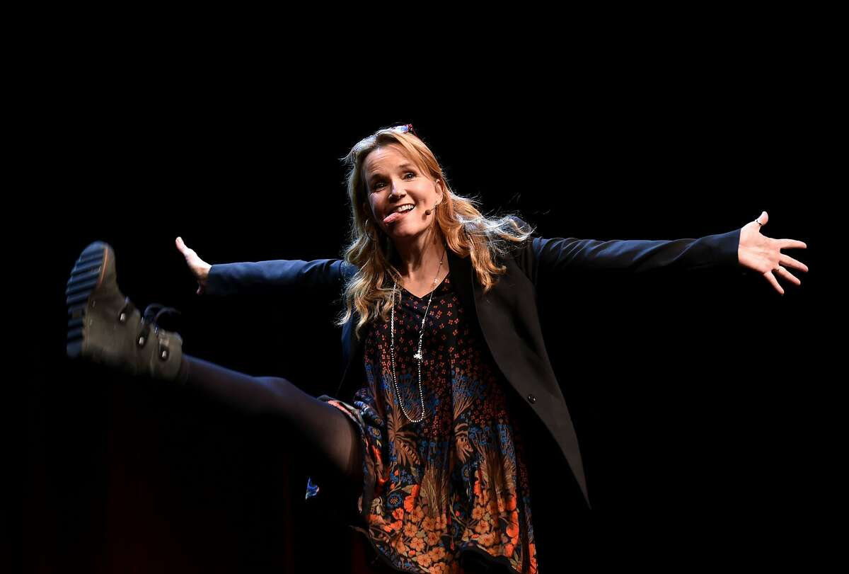 Lea Thompson waves to a cheering crowd before a panel discussion about