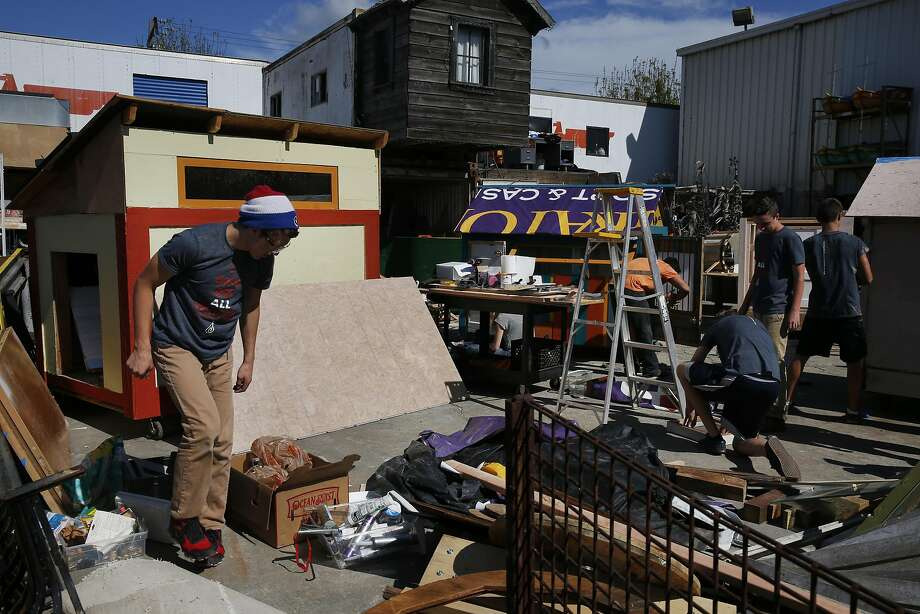 Daniel Dahlberg, 15, joins others to help build tiny homes in Oakland. Photo: Leah Millis, The Chronicle