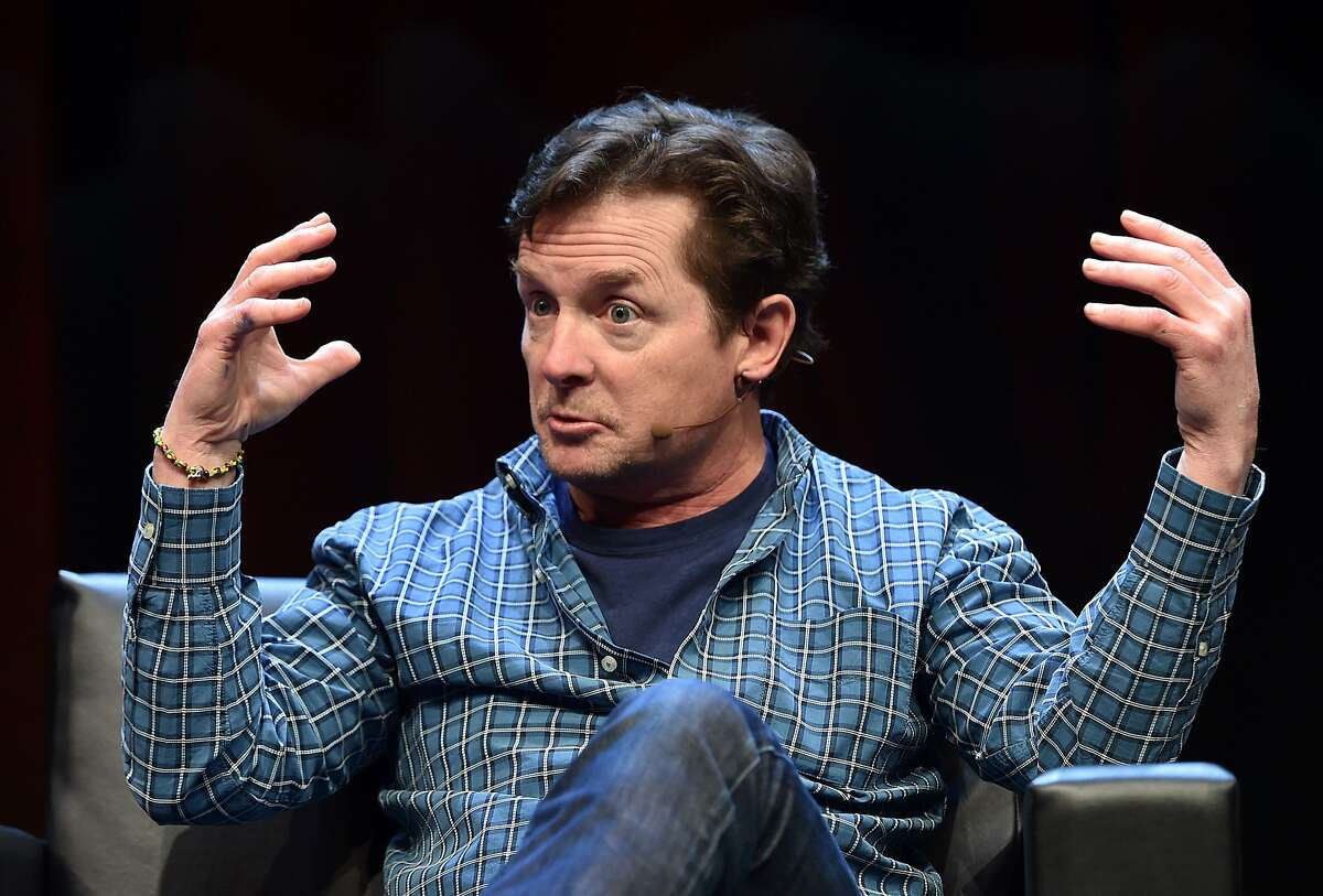 """Michael J. Fox speaks to a crowd during a panel discussion about """"Back to the Future"""" during the Silicon Valley Comic Con in San Jose, California on March 19, 2016. The comic and entertainment-themed event features exhibits, panel discussions and pop culture artistry. Fox starred in the 1985 US science-fiction adventure comedy film """"Back to the Future."""" / AFP PHOTO / JOSH EDELSONJOSH EDELSON/AFP/Getty Images"""