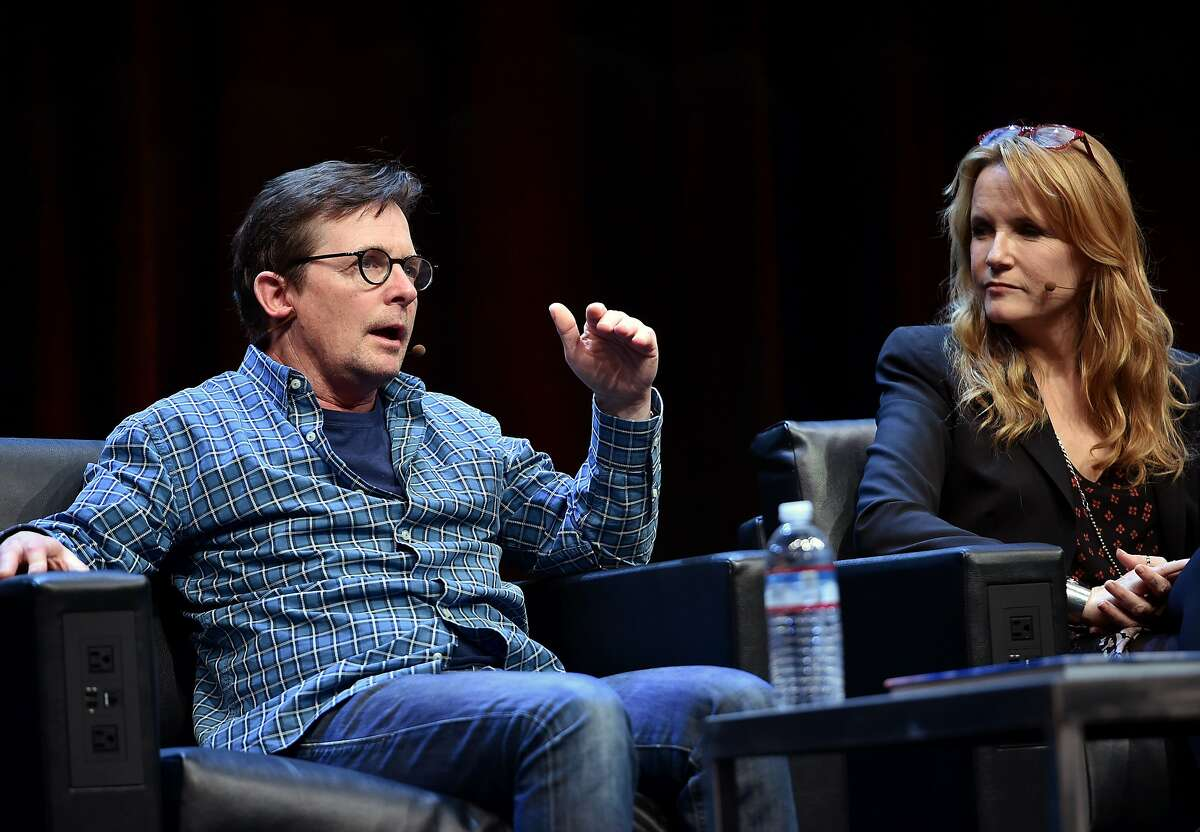 """Michael J. Fox (L) speaks alongside Lea Thompson (R) during a panel discussion about """"Back to the Future"""" during the Silicon Valley Comic Con in San Jose, California on March 19, 2016. The comic and entertainment-themed event features exhibits, panel discussions and pop culture artistry. Fox and Thompson starred in the 1985 US science-fiction adventure comedy film """"Back to the Future."""" / AFP PHOTO / JOSH EDELSONJOSH EDELSON/AFP/Getty Images"""