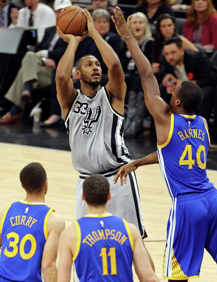 San Antonio Spurs' Boris Diaw shoots over Golden State Warriors' Harrison Barnes as Stephen Curry and Klay Thompson look on during first half action Saturday March 19, 2016 at the AT&T Center. Photo: Edward A. Ornelas, Staff / San Antonio Express-News / © 2016 San Antonio Express-News