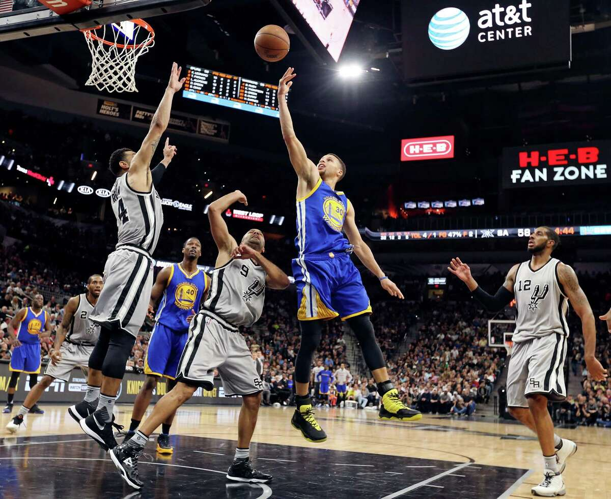 Golden State Warriors' Stephen Curry shoots between San Antonio Spurs' Danny Green (from left), Tony Parker, and LaMarcus Aldridge during second half action Saturday March 19, 2016 at the AT&T Center. The Spurs won 87-79.