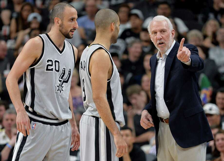 Spurs head coach Gregg Popovich, right, talks to guards Manu Ginobili and Tony Parker during the second half on March 5, 2016, in San Antonio. Photo: Darren Abate /AP / FR115 AP