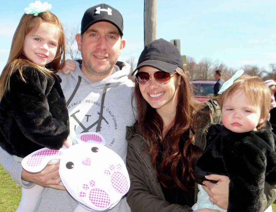 Mike and Rebecca Mallay of Fairfield, with daughters Rylie, 3, and Dylan, 1, at the annual town egg hunt on the South Pine Creek athletic field. Photo: Fairfield Citizen / Mike Lauterborn / Fairfield Citizen