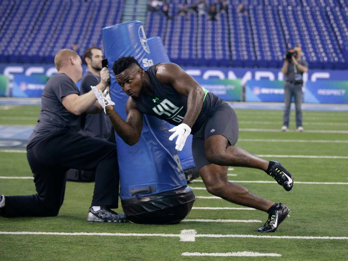 Maryland defensive lineman Yannick Ngakoue runs a drill at the NFL football scouting combine on Tuesday, March 1, 2016, in Indianapolis.