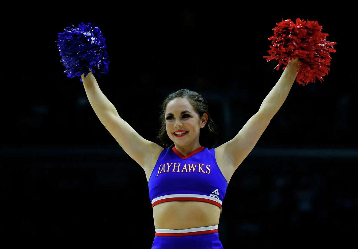 DES MOINES, IA - MARCH 19: Kansas Jayhawks cheerleaders perform in the first half against the Connecticut Huskies during the second round of the 2016 NCAA Men's Basketball Tournament at Wells Fargo Arena on March 19, 2016 in Des Moines, Iowa.