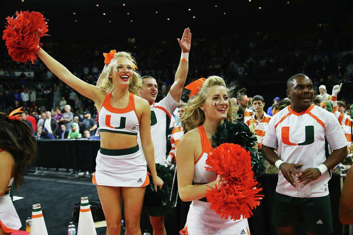 PROVIDENCE, RI - MARCH 19: Miami Hurricanes cheerleaders celebrate after the Miami Hurricanes defeat the Wichita State Shockers during the second round of the 2016 NCAA Men's Basketball Tournament at Dunkin' Donuts Center on March 19, 2016 in Providence, Rhode Island.
