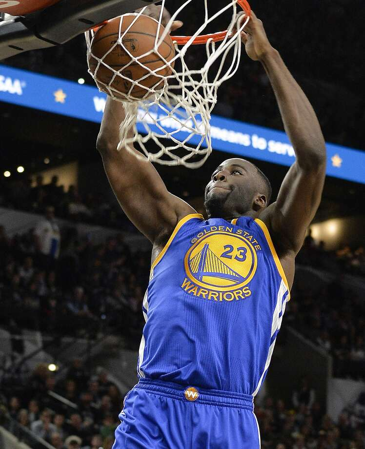 Golden State Warriors forward Draymond Green dunks during the first half of an NBA basketball game against the San Antonio Spurs, Saturday, March 19, 2016, in San Antonio. San Antonio won 87-79. (AP Photo/Darren Abate) Photo: Darren Abate, AP