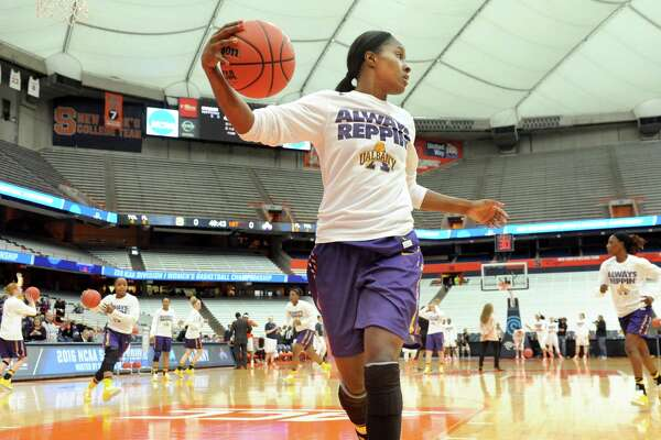 UAlbany's Shereesha Richards, center, warms up before their NCAA second round basketball game against Syracuse on Sunday, March 20, 2016, at the Carrier Dome in Syracuse, N.Y. (Cindy Schultz / Times Union)